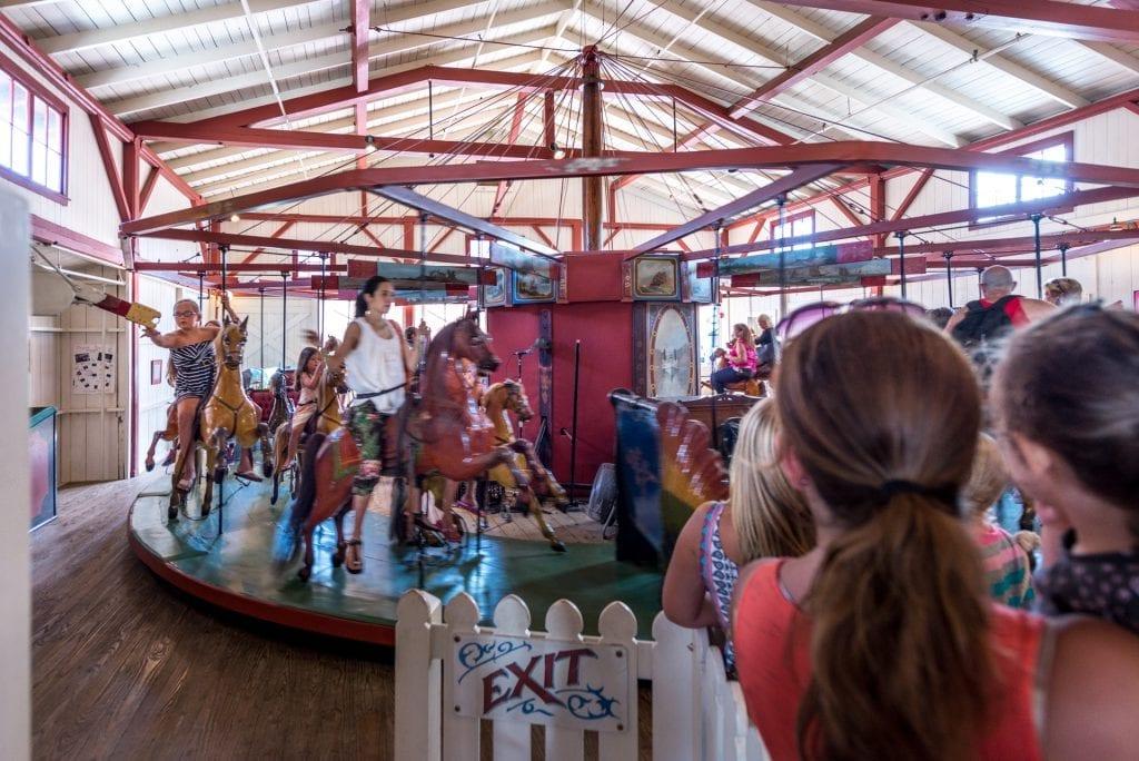 Grabbing The Brash Ring Flying Horses Carousel Oak Bluffs Martha's Vineyard Bucket List