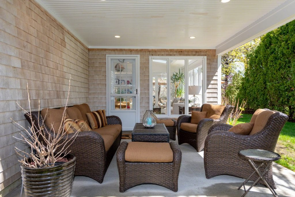 Covered Porch Features Outdoor Living Room 63 Herring Creek Road Edgartown MA 02539 Martha's Vineyard Katama Farmhouse With Standout Style